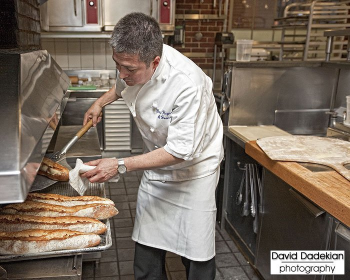 Al Forno's Chef David Reynoso pulling fresh bread from the oven