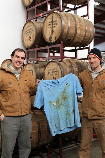 from left to right: Brent Ryan, Head Distiller and Owner of Newport Distilling Company; Mike Rowe's dirty shirt; Adam Truesdale, distiller