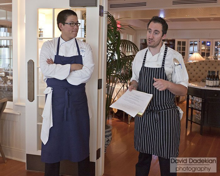 Chefs Haugen and Wagner describe their dishes to the front of house staff