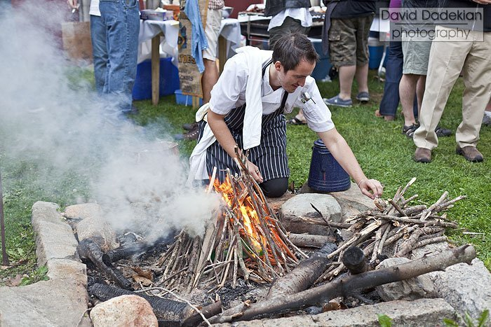 Chef Derek Wagner of Nick's on Broadway gets the picnic bonfire going