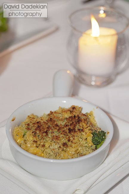 Rotini Mac & Cheese with cheddar mornay, broccoli, house smoked bacon, herb crust