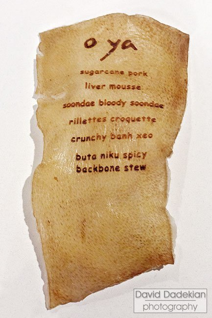 "O Ya's ingenious menu presentation, ""printed"" on pig skin"