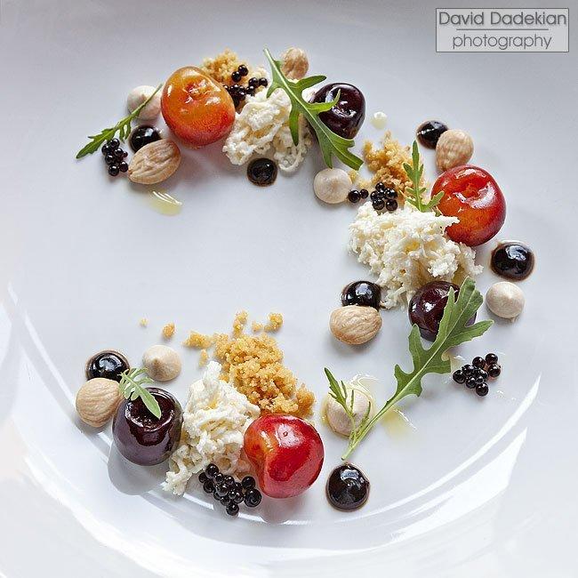 Gracie's Rainier Cherry Salad featuring Stracciatella cheese, wild arugula, aged balsamic, and Marcona almonds