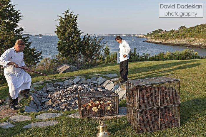 Hart rakes the wood coals as McCarthy observes