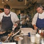 Chefs Matthew Jennings and Beau Vestal cooking in the James Beard Foundation kitchen